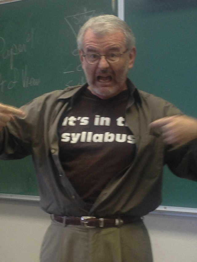 David Lydic using his t shirt, that reads it's in the syllabus, to answer a student question that is in the syllabus.