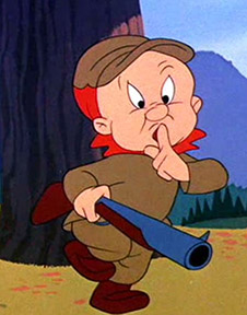 Elmer Fudd holding finger to lips while hunting