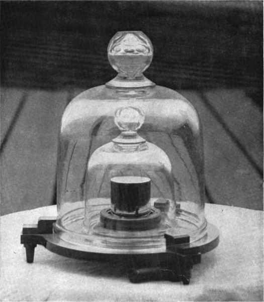 The original Kilogram stored in several bell jars.