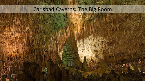 A slide filed with an image of the Carlsbad Cavern Big room. With a text box filled with translucent white and black text.